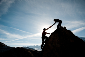 Image of people helping each other